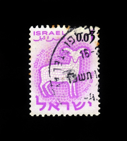 twelve month old: ISRAEL - CIRCA 1961  A stamp printed in the Israel, shows sign of the zodiac Aries, Ram, - month of Nisan, circa 1961