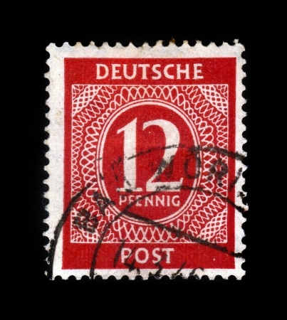 nominal: GERMANY - CIRCA 1946  A stamp printed in  Germany shows postage stamp times of the allied occupation, nominal value 12 pfennig, series, circa 1946