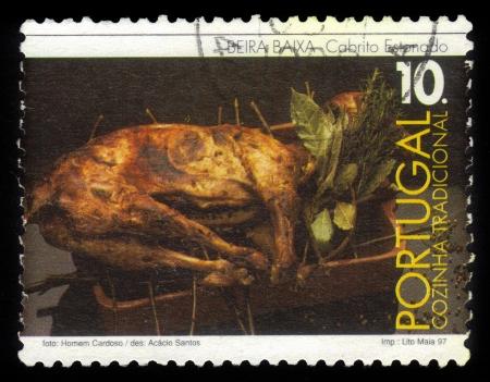 baixa: PORTUGAL - CIRCA 1997  A stamp printed in Portugal shows a roast kid  cabrito estonado   traditional dish of Beira Baixa Province, Portugal, circa 1997 Stock Photo