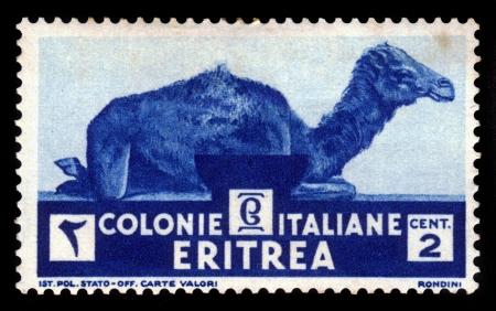 camel post: ERITREA - CIRCA 1934  A stamp printed by Italian colony of Eritrea shows camel, series mammal animals, circa 1934 Stock Photo