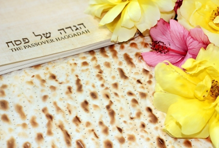 Haggadah in Hebrew with yellow flowers photo