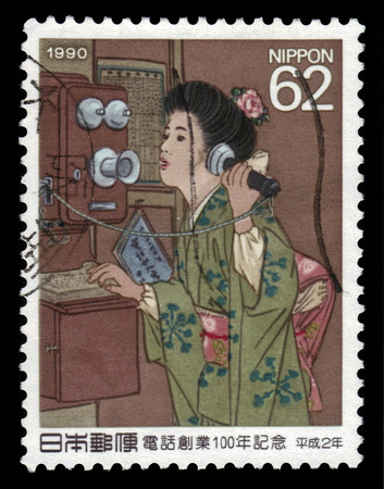 JAPAN - CIRCA 1990  A stamp printed in Japan shows women using telephone, painting by Nakamura, centennial phone founding, circa 1990 photo