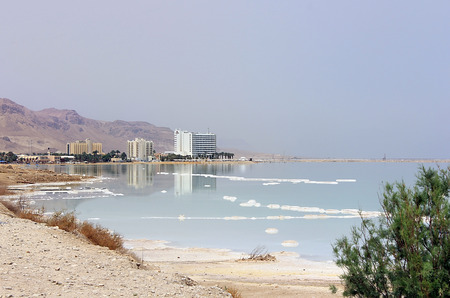 hotel complex at the Dead Sea and salt deposits, Israel photo