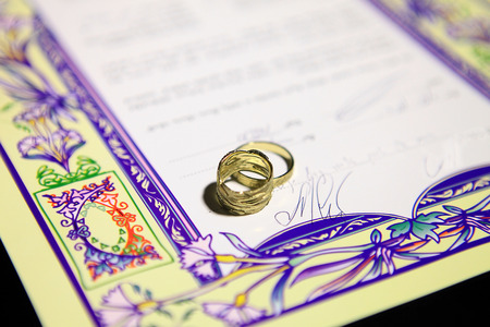jewry: wedding rings and Ketubah - a prenuptial agreement in jewish religious tradition Editorial