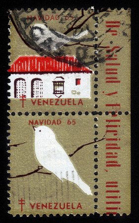 Venezuela - CIRCA 1965  A stamp printed in Venezuela shows white bird on a branch, series Christmas, circa 1965 photo