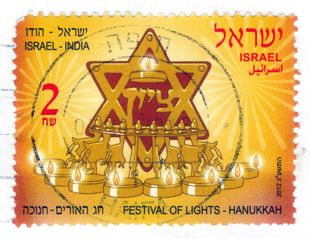 ISRAEL - CIRCA 2012  a stamp printed in Israel, shows attributes and symbols of jewish festival of Hanukkah with inscription   Israel - India ; series, circa 2012
