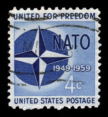 north atlantic treaty organization: UNITED STATES OF AMERICA - CIRCA 1959  a stamp printed in the United States of America shows NATO Emblem, 10th anniversary of North Atlantic Treaty Organization, circa 1959