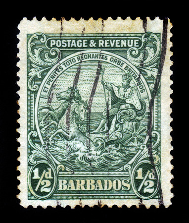 BARBADOS - CIRCA 1925  A stamp printed in Barbados shows badge of the colony, portrait of George V, King of England, riding on a chariot across the sea, circa 1925