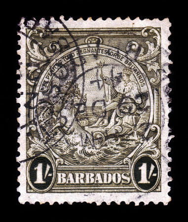 BARBADOS - CIRCA 1938  A stamp printed in Barbados shows badge of the colony, portrait of George VI, King of England, riding on a chariot across the sea, circa 1938