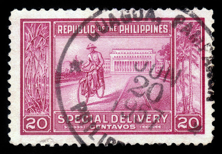 PHILIPPINES - CIRCA 1947  a stamp printed in Philippines shows Manila Post Office and postman on a bike, circa 1947