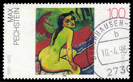 GERMANY - CIRCA 1996  A stamp printed in German Federal Republic shows picture of a naked woman painted by Max Pechstein, circa 1996 Editorial