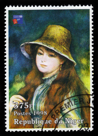 Republic of Niger - CIRCA 1998 A stamp printed in Republic of Niger shows a painting of young girl in straw hat by french painter Pierre Auguste Renoir  Impressionist painter , circa 1998