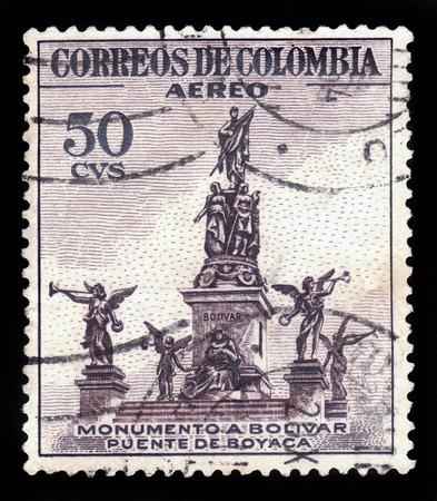 allegoric: COLOMBIA - CIRCA 1954  A postage stamp printed in Colombia shows the Monumento a Bolivar, Puente de Boyaca, circa 1954 Stock Photo