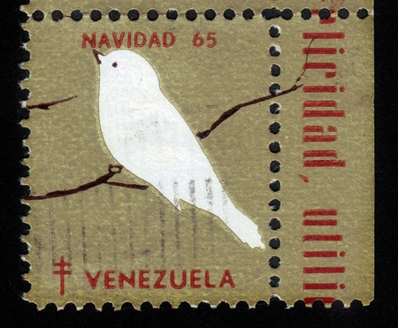 Venezuela - CIRCA 1965  A stamp printed in Venezuela shows white bird on a branch, series Christmas, circa 1965