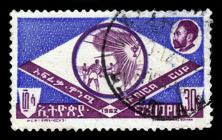 amharic: ETHIOPIA - CIRCA 1962   stamp printed in Ethiopia shows african football cup and Haile Selassie I portrait, circa 1962