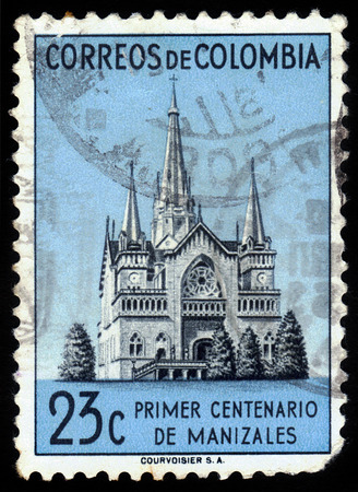neogothic: COLOMBIA - CIRCA 1952  A stamp printed in Colombia showing the Cathedral of Manizales, a neo-gothic church, circa 1952 Stock Photo