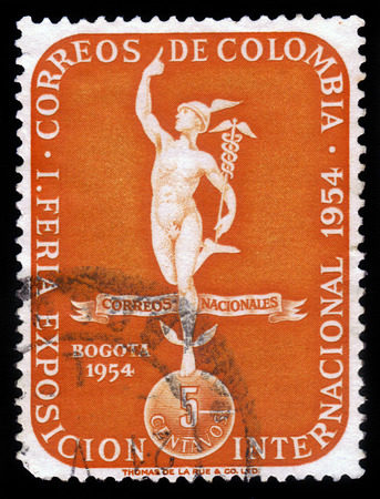 COLOMBIA - CIRCA 1954  A stamp printed in Colombia showing god of commerce Mercury, symbol of I international fair exhibition in Bogota, circa 1954 photo