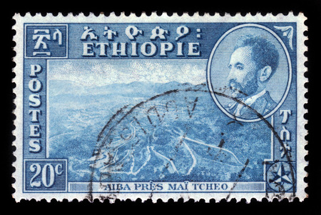 amharic: ETHIOPIA - CIRCA 1947  stamp printed in Ethiopia shows landscape Aiba near Mai  Tcheo and Emperor Haile Selassie I portrait, circa 1947 Stock Photo