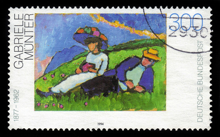 expressionist: GERMANY - CIRCA 1994  a stamp printed in the Germany shows Couple Lying on Grass   Jawlensky and Werefkin  , painting by Gabriele Munter, german expressionist painter, circa 1994 Editorial