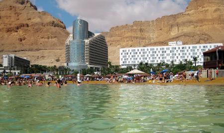 Dead Sea, Ein Bokek, Israel - May 28  vacationers and tourists bathe in the Dead Sea on the background of luxury hotels, on May 28, 2014 in Ein Bokek, Dead Sea, Israel