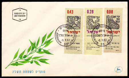 isaiah: ISRAEL - CIRCA 1962  a postal envelope printed in Israel, shows a stylized illustration of the prophecies of Isaiah, chapter 11, verses 6 and 8, issue in honor of the holiday of Rosh Hashanah 5723  1962  ,circa 1962
