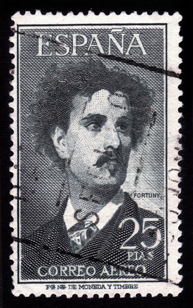 mariano: SPAIN - CIRCA 1956  A stamp printed in SPAIN shows portrait of Mariano Fortuny y Madrazo, spanish fashion designer who opened his couture house in 1906, circa 1956