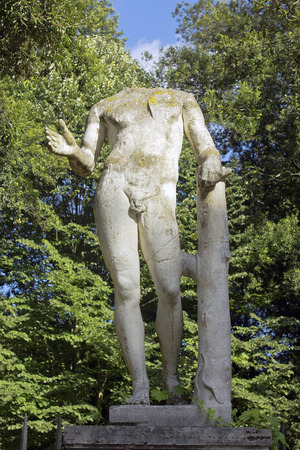 ancient statue of a nude man without a head, an unknown author, the Villa Borghese gardens, Rome, Italy