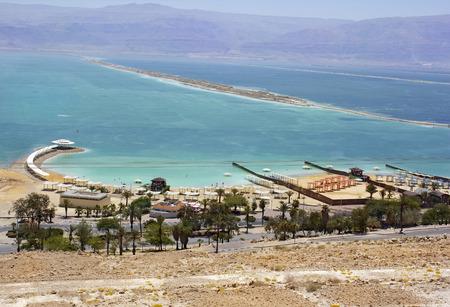 Ein Bokek beach on the shores of the Dead Sea, Israel photo