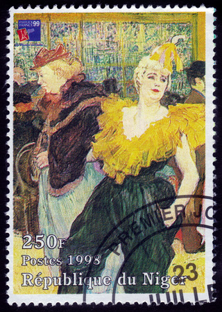 Republic of Niger - CIRCA 1998 A stamp printed in Republic of Niger shows a painting of the clown Cha-U-Kao at the Moulin Rouge by french painter Henri De Toulouse-Lautrec, circa 1998