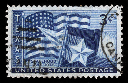 statehood: UNITED STATES OF AMERICA - CIRCA 1945: A stamp printed in USA shows flags of the United States and the State of Texas, Texas Statehood, 100th Anniversary, circa 1945