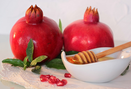 traditional jewish food, honey and pomegranate for the holiday of Rosh Hashanah