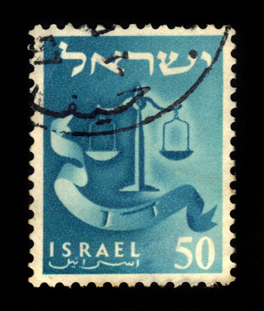 judaic: ISRAEL - CIRCA 1956: A stamp printed in Israel shows the emblem of Dan Tribe and with an inscription in Hebrew