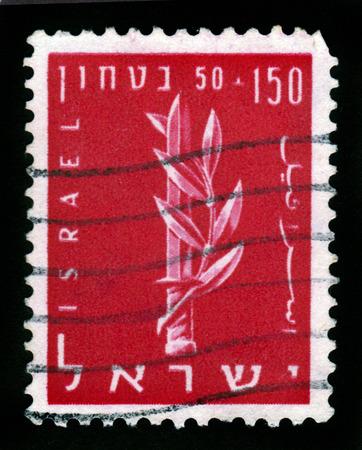 zionist: ISRAEL - CIRCA 1957: A stamp printed in Israel shows the emblem of the Haganah, Jewish paramilitary organization, series Security of Israel, circa 1957 Stock Photo