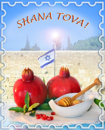 Congratulation to the holiday Rosh Hashanah, traditional jewish food, honey and pomegranate for the holiday of Rosh Hashanah on the background of the Western Wall in Jerusalem