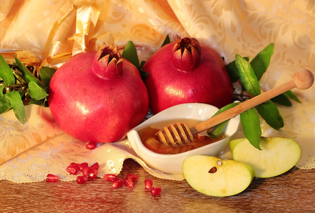 traditional jewish food, honey, apples and pomegranate for the holiday of Rosh Hashanah photo