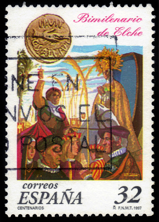 Spain - CIRCA 1997: A stamp printed in Spain, shows roman coin and Arrival of the Virgin at Tamarit beach, painting by Jose Canizares Botella, circa 1997 Editorial