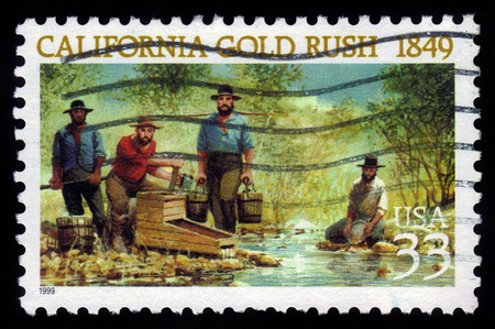 mining gold: USA - CIRCA 1999: a stamp printed in USA shows american prospectors looking for gold in California, California Gold Rush, 150th Anniversary, circa 1999