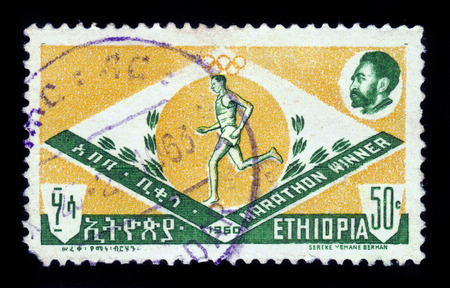 ETHIOPIA - CIRCA 1962 : stamp printed in Ethiopia shows marathon runner and portrait Haile Selassie I, circa 1962 Editorial