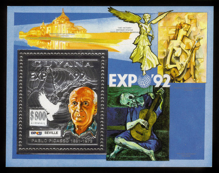 Guyana - CIRCA 1992: a souvenir sheet printed in Guyana, shows a portrait of Pablo Picasso, against the background of his paintings, circa 1992