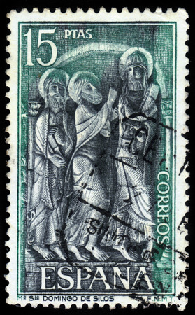 Spain - CIRCA 1973: A stamp printed in Spain, shows Three saints, bas-relief from cloister in the Monastery of Santo Domingo de Silos, circa 1973