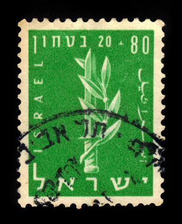 zionist: ISRAEL - CIRCA 1957: A stamp printed in Israel shows the emblem of the Haganah, Jewish paramilitary organization, series Security of Israel, green, circa 1957