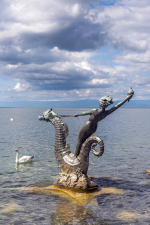 vevey: Vevey, Switzerland - September 01: sculpture in the form of a girl with a seashell on the seahorse by Edouard-Marcel Sandoz, Vevey, Lake Geneva, Switzerland on September 01, 2014