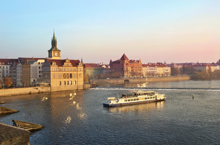 PRAGUE, Czech Republic - November 14:Tourists float on a boats on the Vltava river on the background a beautiful view over Prague on November 14, 2012 in Prague, Czech Republic