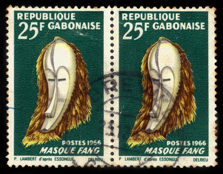 GABON - CIRCA 1966: A stamp printed in the Gabon shows a traditional mask of Fang tribe, circa 1966 Editorial