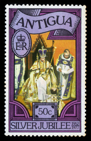 reign: Antigua and Barbuda  - CIRCA 1977: A stamp printed in Antigua, shows image of Queen Elizabeth II, silver jubilee of the reign, circa 1977