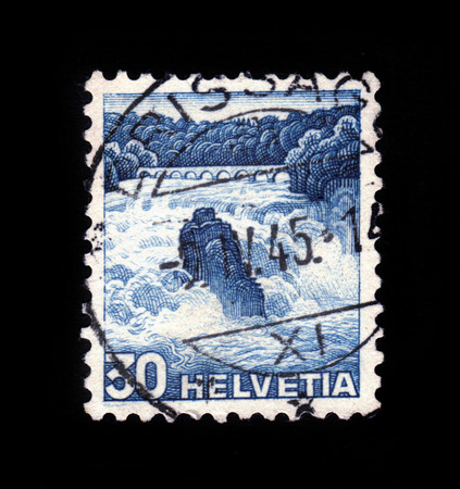 SWITZERLAND - CIRCA 1936: A stamp printed in Switzerland shows Rhine Falls near Schaffhausen, circa 1936