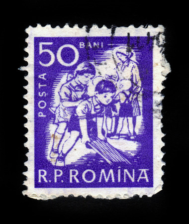 ROMANIA - CIRCA 1960: A stamp printed in Romania shows children at play, swinging on swings, circa 1960 photo