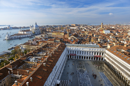 procuratie: beautiful view from a top St Mark Campanile ( bell tower ) of the Grand Canal and Basilica Santa Maria della Salute and Piazza San Marco with old and new Procuratie in Venice, Italy Stock Photo