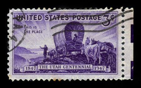commemorating: United States - CIRCA 1947: A stamp printed in United States shows the first settlers in Utah, commemorating the Centennial of Utah, circa 1947 Stock Photo