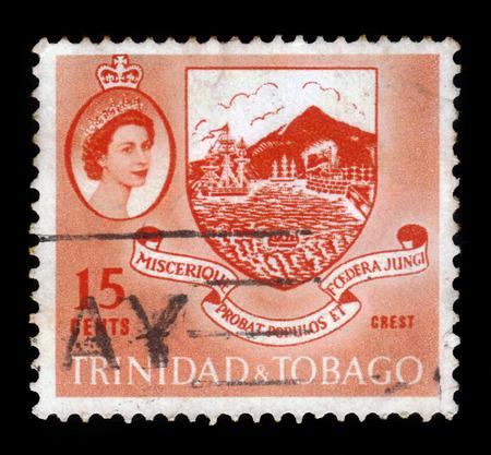 TRINIDAD AND TOBAGO - CIRCA 1960: A stamp printed in Trinidad and Tobago shows Colony Coat of Arms and Queen Elizabeth II, circa 1960